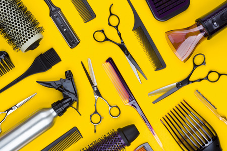 Hairdresser tools, accessories and combs on yellow Banco de Imagens