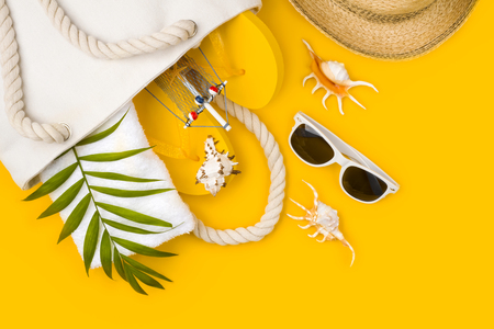 Tropical beach accessories on yellow