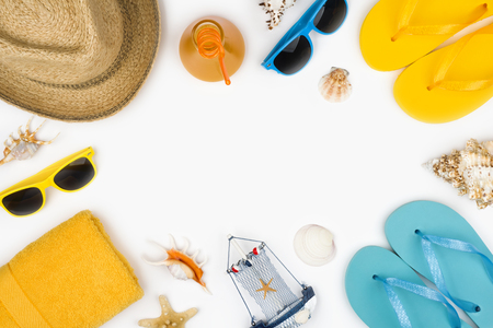 Summer vacation concept with travel accessories arranged on white Banco de Imagens