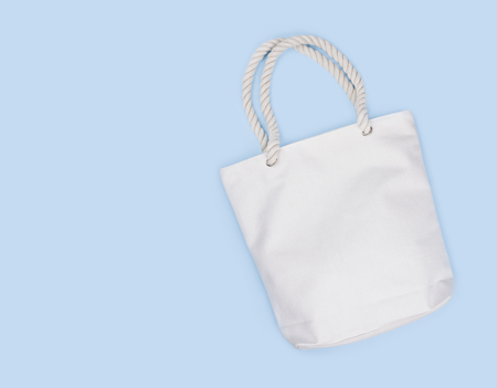 Mockup of blank white fabric bag isolated on blue