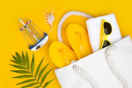 Summer travel concept. Vacation symbols and accessories on yellow Banco de Imagens