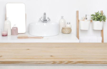 Wooden tabletop for product display over defocused bathroom interior
