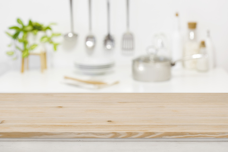 Wood table top for product display on blurred kitchen background Banco de Imagens
