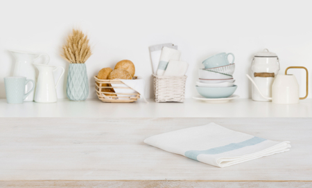 Dish cloth on wooden table over defocused kitchen counter background Banco de Imagens - 120977890