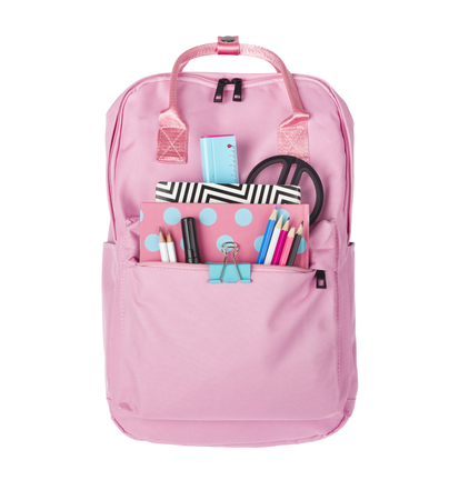 Girlish backpack full of school supplies isolated on white