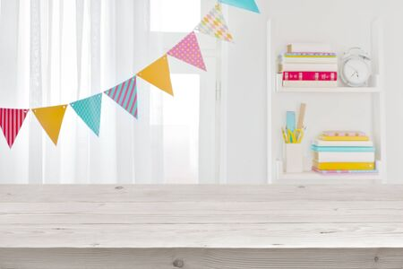 Wooden surface for product display on blurred room of schooler Banco de Imagens - 125686705