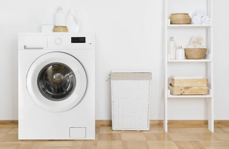 Laundry room interior with washing machine and shelf near wall Banco de Imagens - 125686722