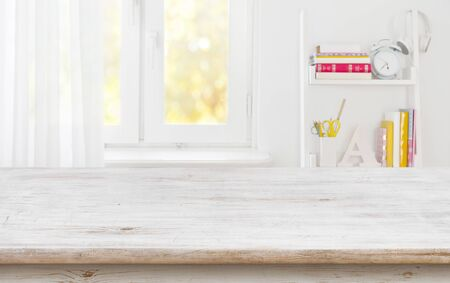 Rustic wood table for product display over blurred schooler room