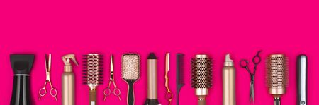 Professional hair dresser tools on red  with copy space