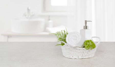 Purity concept with decorated bathroom accessories on stone table Banco de Imagens - 129360530