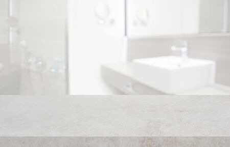 Stone table top and blurred hotel bathroom interior