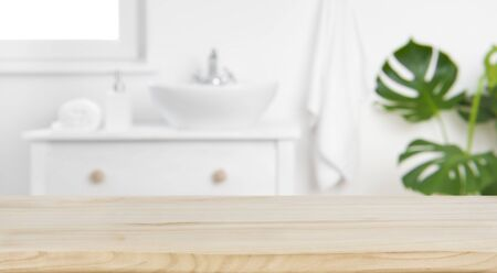 Wood tabletop on blur bathroom