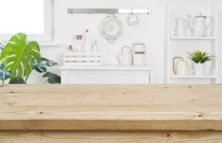 Wood table top for product display on blur kitchen