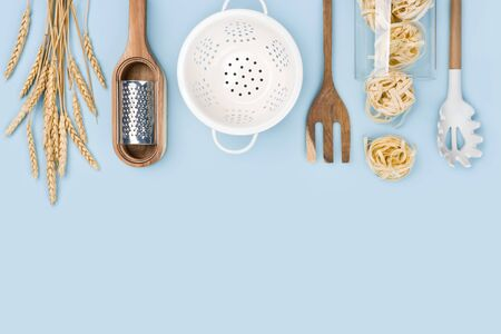 Top view of baking tools and ingredients on blue background