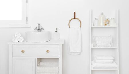 Bathroom interior with simple stylish furniture and various hygiene tools 写真素材
