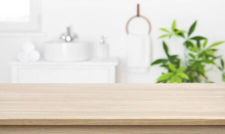 Empty tabletop for product display with blurred bathroom interior Stock Photo