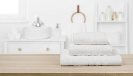 White towels on table and copy space over bathroom