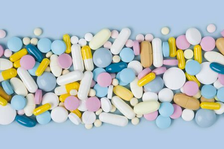 Lots of various colorful medicine drugs, pills, tablets and capsules 写真素材