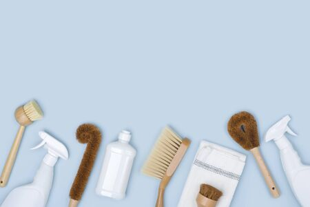 Concept of natural cleaning with brushes, detergent bottles and cloth