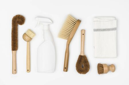 Natural cleaning products dish brush, detergent and cloth on white