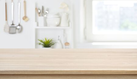 Wooden texture table top on blurred kitchen window background