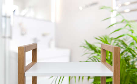 Empty wooden trolley top and blurred bathroom interior as background