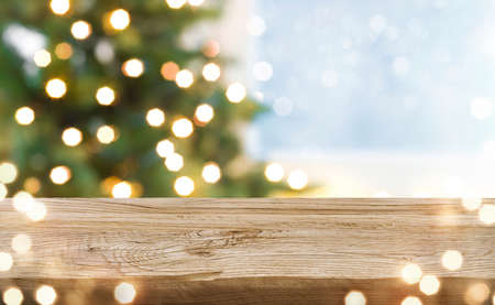 Unique texture wooden board and blurred winter holiday lights background Standard-Bild