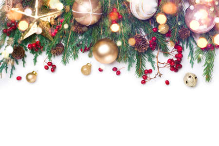 Christmas border of fir branches decorated in red and gold