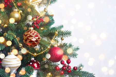 Decorated Christmas fir tree on abstract lights background