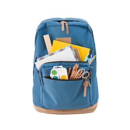 Blue school backpack with various supplies isolated on white background