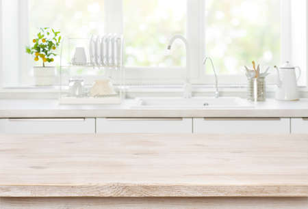 Wooden table on blurred backgrounds of kitchen white sink window Stock fotó