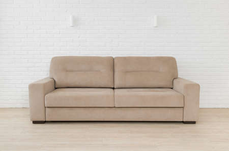 Sofa in living room interior on white brick wall background