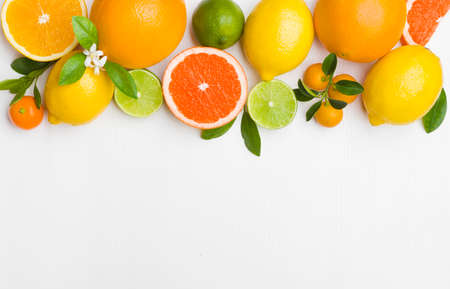 Top view on citrus fruits on table with copy space