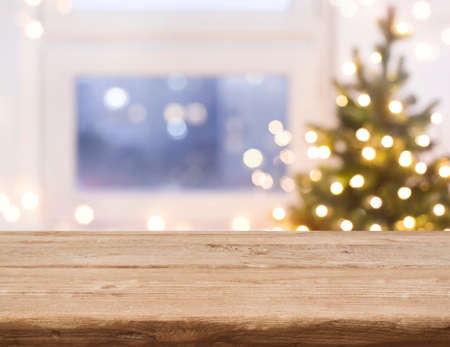 Desk space in front of defocused window with christmas tree