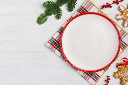 Holiday dinner background concept with empty plate for product display Standard-Bild