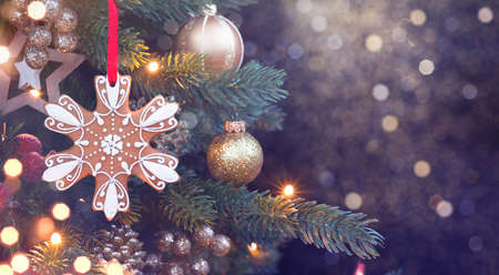 Christmas decorations on holiday tree and abstract evening lights background Standard-Bild