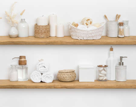 Body care cosmetics with spa accessories arranged on wooden shelves