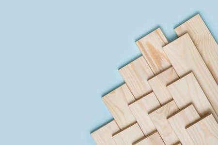 Wood timber construction material on blue background with copy space