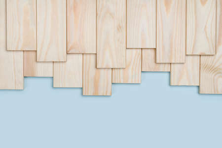 Wooden planks on blue background with copy space at bottom
