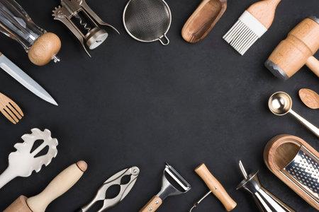 Various kitchen utensils set on black background with copy space Standard-Bild