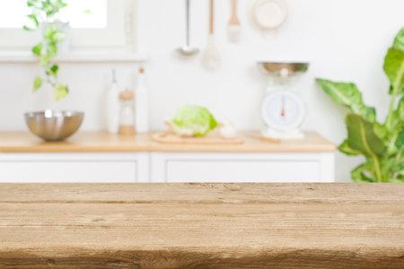 Wood table top on blur kitchen room counter background Standard-Bild
