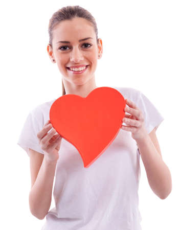 Smiling beautiful girl holding heart photo