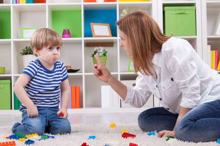 disobedient child: Angry mother scolding a disobedient child Stock Photo