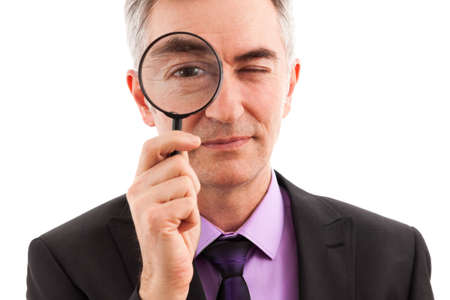 inspect: Businessman searching with magnifier Stock Photo