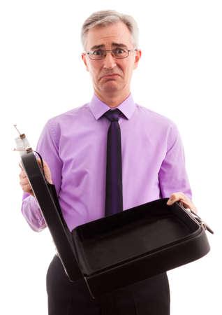 freaked: Senior comedy sad businessman standing Stock Photo