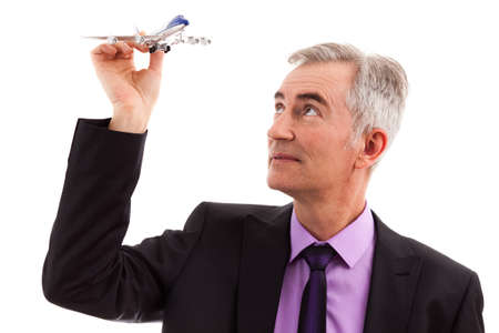 Senior business man holding a airplane isolated photo
