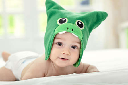 girl in a hat: Baby with funny cap on head Stock Photo