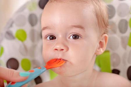 Beautiful sweet baby eating watermelon photo