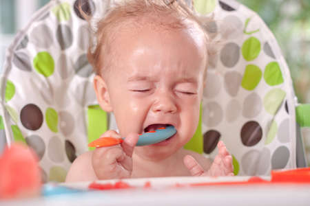 disobedient child: Angry sad disobedient baby child will not eat, feeding problems