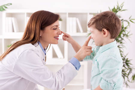 Young doctor and child enjoy and playing together touching noses